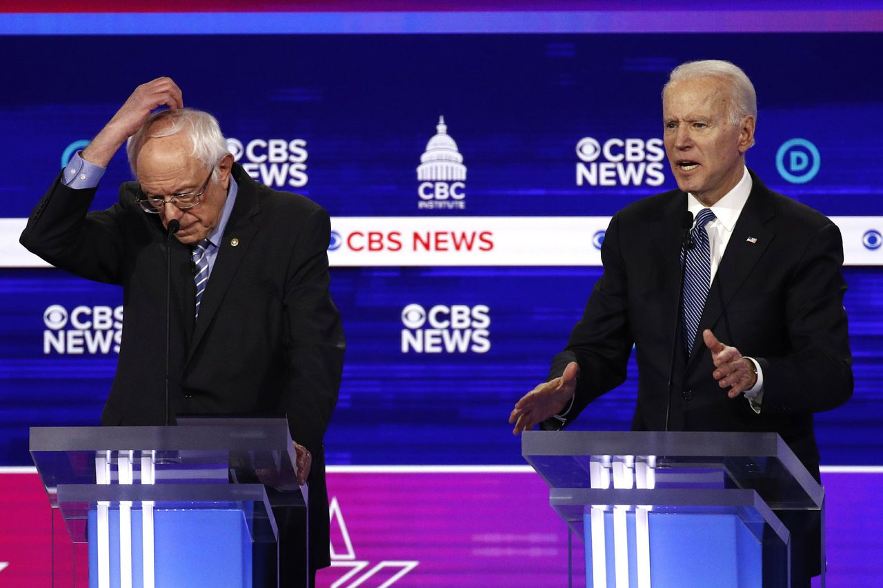 Sanders, Biden face each other in last Democratic debate before nomination announcement. Image via AP.