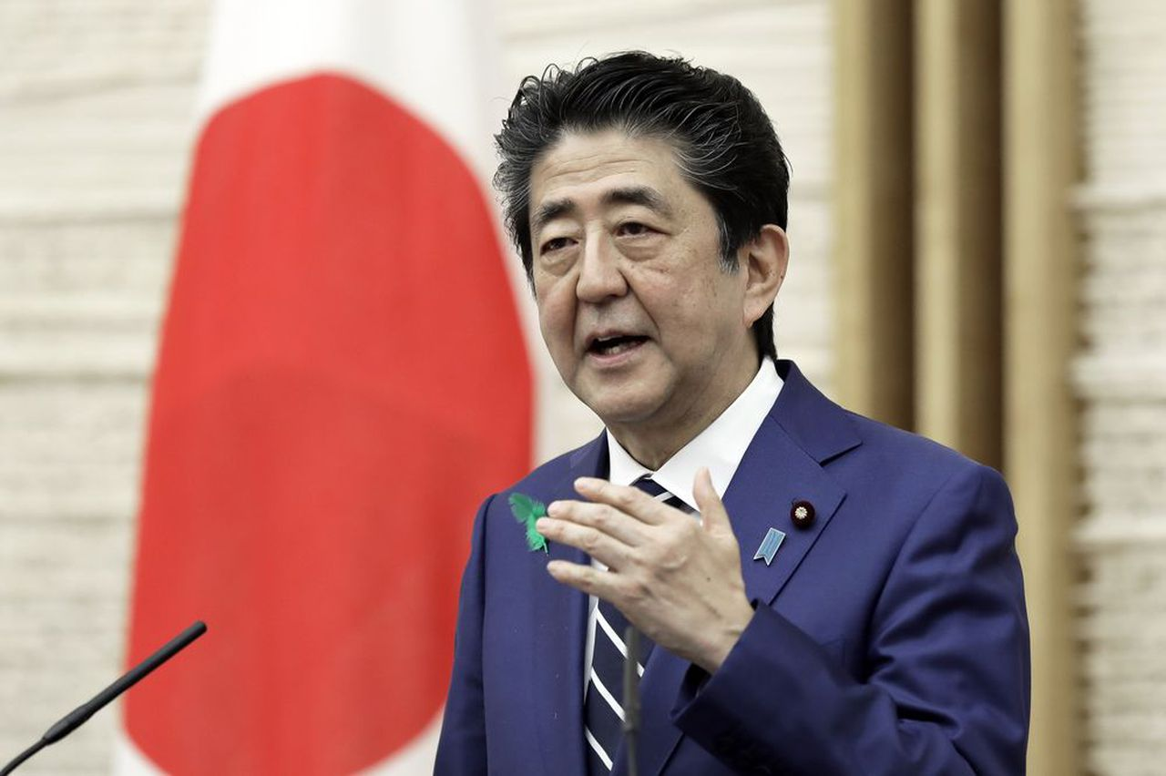 Shinzo Abe will suspend Japan's state of emergency tonight
