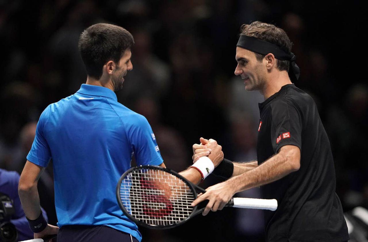 Federer delivers a clinical win over rival Djokovic in ATP finals. Image via PA.
