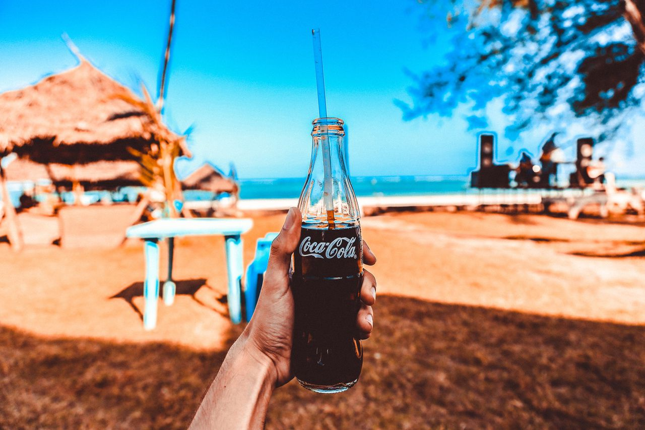 Coca Cola is committed to reducing its carbon footprint. Image Via Packaging News