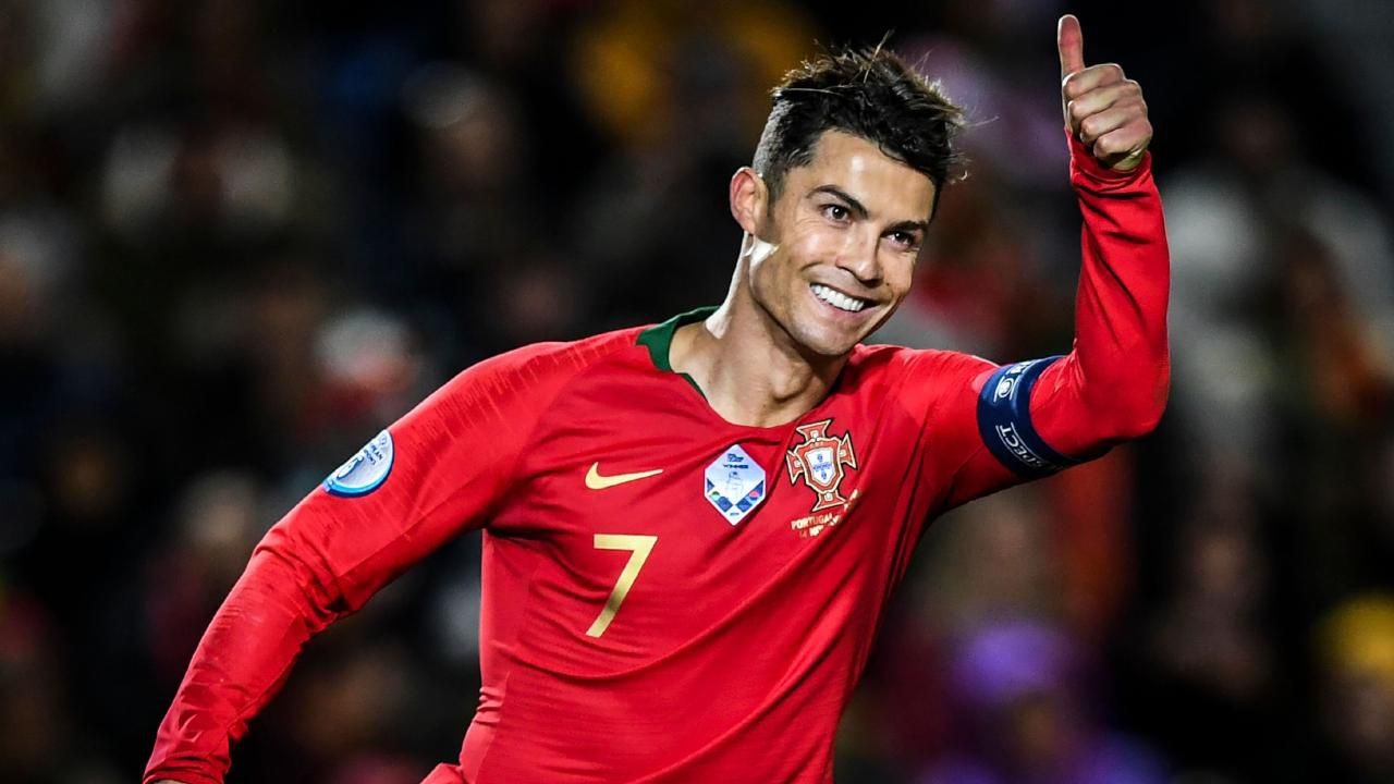 Cristiano Ronaldo reached 98 international goals with a hat-trick against Lithuania. Image via AFP.