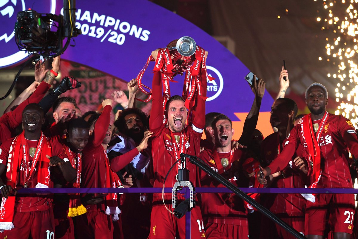 Liverpool finally lifts the English Premier League trophy following an action-packed 5-3 win against Chelsea at Anfield